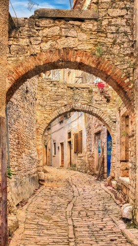 Paved alley in the historic village of Labin, a secret treasure located on the South East coast of Istria in Croatia.