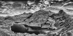 View from Passo del Mezzeno over the Twin Lakes, set into the world famous peaks of the Orobic Alps, Pizzo del Becco, Pizzo Farno, and Monte Corte.