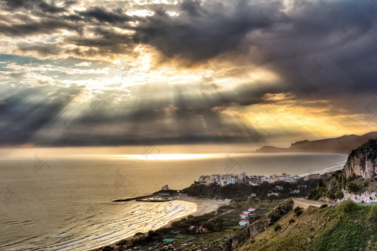 Sunrays breaking through the clouds over Sperlonga