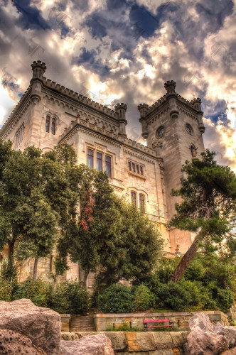 Miramare castle and its West tower overlooking the natural bay of Grignano