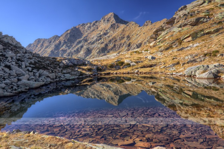 Mont Mars reflected in the clear water of the Laghetto di Monterosso (Riserva Naturale di Mont Mars - Valle d'Aosta, Italy)