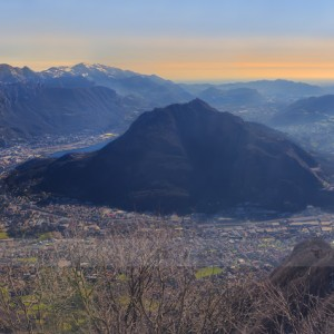 Panoramic view from Corni di Canzo (Italy.) The city of Lecco, right on the Como lake, and behind the city the well known mountain called Resegone. In the middle, Monte Barro and, on the right side, lake Annone and Lake Pusiano.