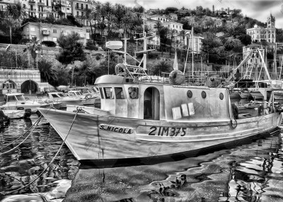 Fishing boat St. Nicholas moored in the harbor of Bordighera