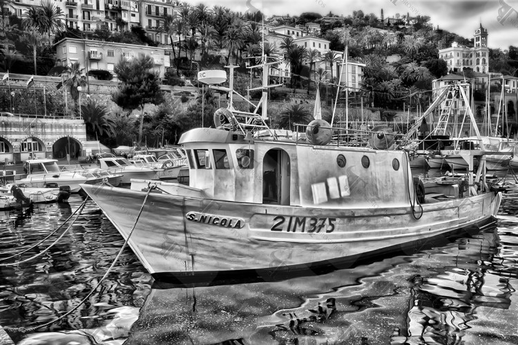 Fishing boat St. Nicholas moored in the harbor of Bordighera