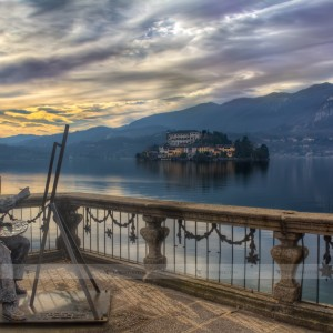 Statue of a painter in the townhall backyard on the lake Orta in front of the Isola San Giulio, Piedmont - Italy